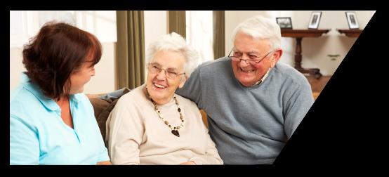 elderly couple and caregiver having conversation