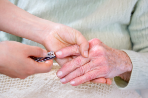 Cutting Elderly hands nail