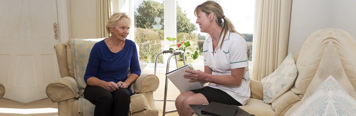 caregiver and elderly woman having conversation